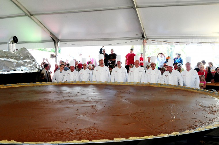 Halloween Fun Fact: The biggest pumpkin pie on record was 20 feet in diameter and weighed 3,699 pounds. It was baked by the New Breman Giant Pumpkin Growers in Ohio in 2010, breaking their own previous world's record of 2,020 pounds. The ginormous orange pie contained 1,212 pounds of pumpkin, 233 dozen eggs, 109 gallons of evaporated milk, 525 pounds of sugar, 7 pounds of salt, and 14.5 pounds of cinnamon.